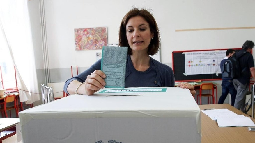 Alessandra Moretti, the center-left candidate for Veneto region's governor, casts her ballot at a polling station in Vicenza, Italy, Sunday, May 31, 2015. Italians vote in several regions for governors and in dozens of municipalities for local posts in balloting seen as a limited test for Premier Matteo Renzi's grip on the leadership of his oft-squabbling Democratic Party. (Filippo Venezia/ANSA via AP)