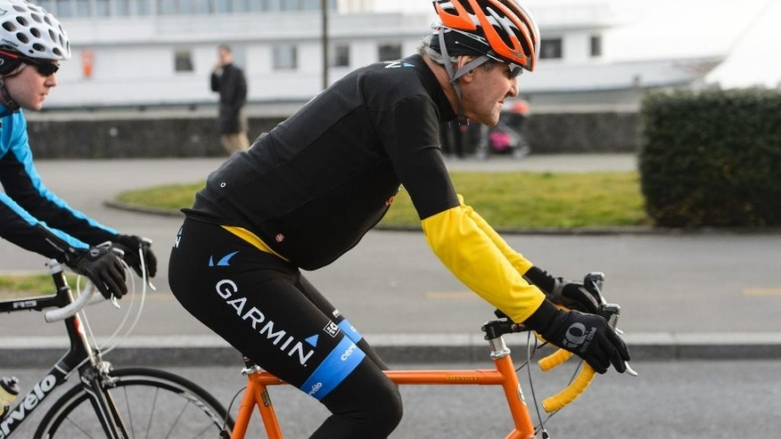 FILE - In this March 16, 2015 file picture  U.S. Secretary of State John Kerry, rides a bike after a bilateral meeting with the  Iranian Foreign Minister  in Lausanne, Switzerland.  Kerry is in stable condition in a Swiss hospital after suffering a leg injury in a bike crash outside Geneva  Switzerland  on Sunday, May 31, 2015. (Jean-Christophe Bott,Keystone via AP, file)