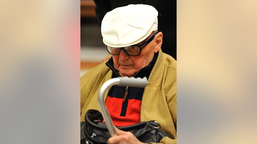 Former Hungarian interior minister in the communist-era  Bela Biszku arrives in the courtroom  in Budapest,  Monday, June 1, 2015. The Hungarian appeals court has ordered the retrial of the communist-era official convicted of war crimes related to reprisals against civilians after the anti-Soviet revolution of 1956. Bela Biszku  was sentenced to five years and six months in prison in May 2014. Prosecutors appealed the sentence, asking for life in prison for the 93-year-old former interior minister, while Biszku's defense sought the dismissal of the charges. ( Tamas Kovacs/MTI via AP)