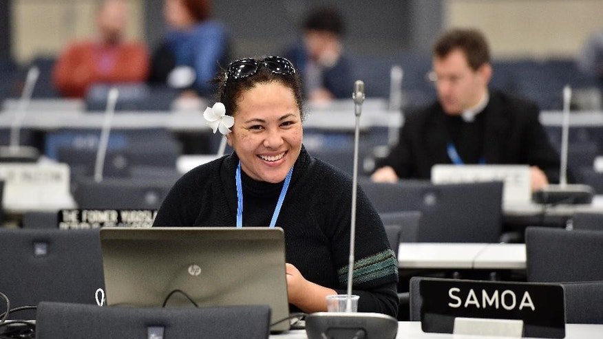 A delegate from Samoa smiles during the United Nations Framework Convention on Climate Change in Bonn, Germany, Monday, June 1, 2015. (AP Photo/Martin Meissner)