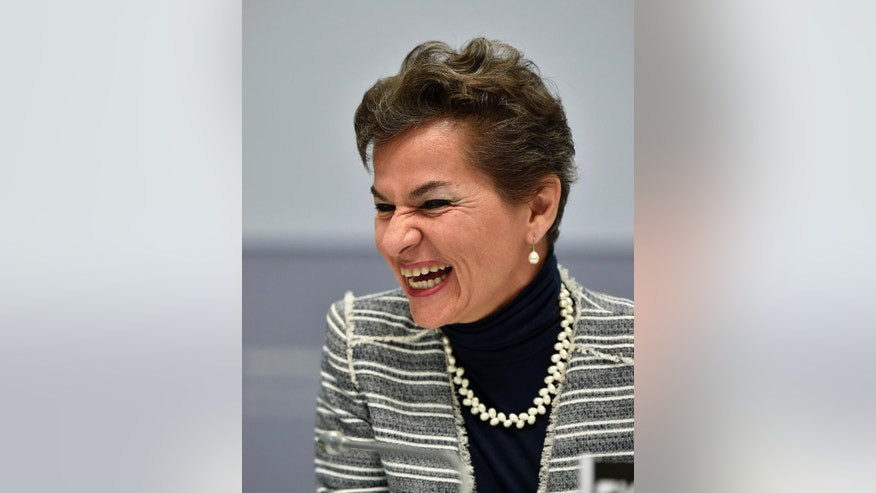 Executive Secretary Christiana Figueres smiles during the United Nations Framework Convention on Climate Change in Bonn, Germany, Monday, June 1, 2015. (AP Photo/Martin Meissner)