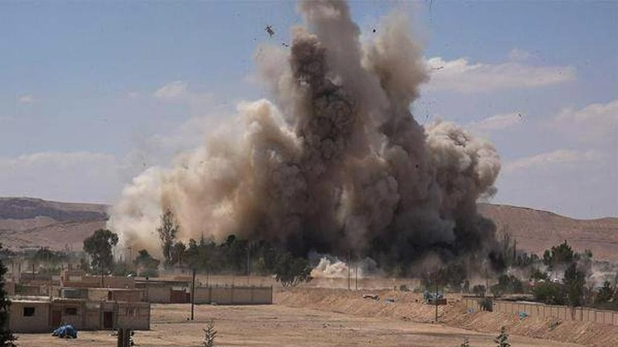 FILE - This photo released on Saturday, May 30, 2015 by a militant website, which has been verified and is consistent with other AP reporting, shows Tadmur prison, blown up and destroyed by the Islamic State group in Palmyra (Tadmur in Arabic), Homs province, Syria. The prison was where government opponents were held, and reports over the years said it was the site of beatings and torture. (Militant website via AP, File)