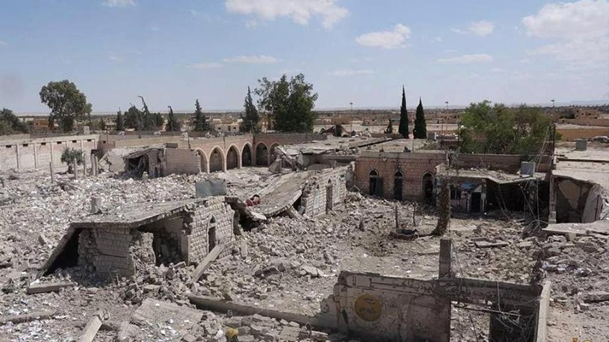 FILE - This photo released on Saturday May 30, 2015 by a militant website, which has been verified and is consistent with other AP reporting, shows Tadmur prison, blown up and destroyed by the Islamic State group in Palmyra (Tadmur in Arabic), Homs province, Syria. The prison was where government opponents were held and reports over the years said it was the site of beatings and torture. (Militant website via AP, File)
