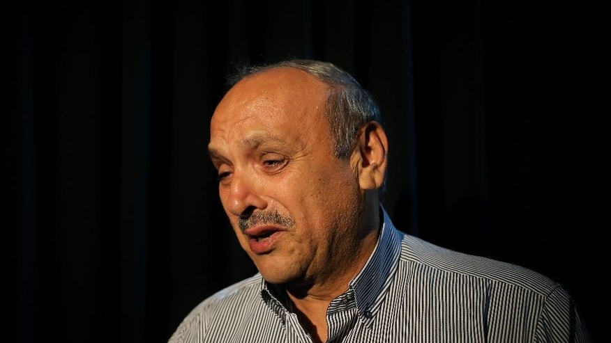 Ali Aboudehn, 65, one of the former Lebanese detainees who was held in Syria's infamous Tadmur Prison, cries as he talks about the days at the prison, during an interview with The Associated Press in Beirut, Lebanon, Monday, June 1, 2015. Aboudehn said he was regularly beaten and humiliated during the four years and eight months he spent there. (AP Photo/Hussein Malla)