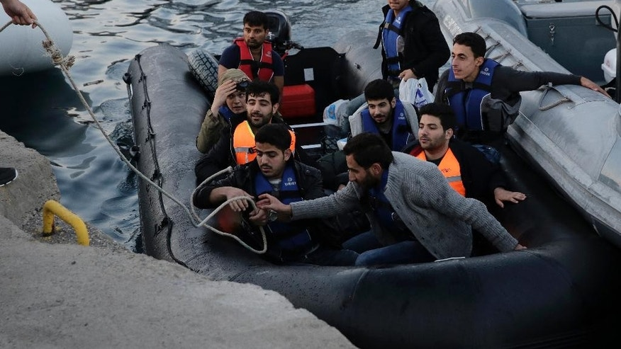 Syrian migrants aboard a dinghy arrive at the port of Kos island following a rescue operation by Greek Coast Guard in a part of the Aegean Sea between Turkey and Greece Sunday, May 31, 2015. Greece and Italy are the main points of entry into the European Union for refugees and economic migrants from the Middle East and Africa hoping to reach other European Union countries. (AP Photo/Petros Giannakouris)
