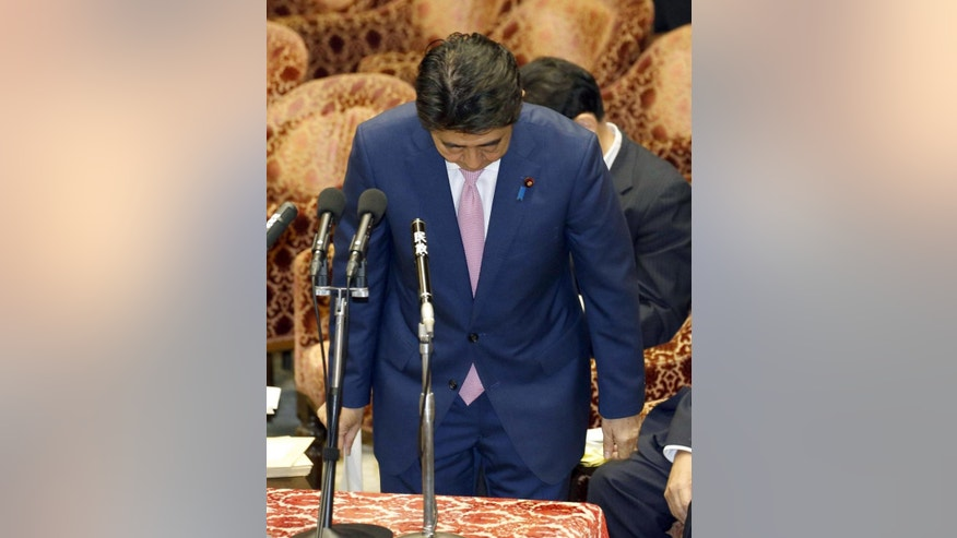 Japanese Prime Minister Shinzo Abe bows at the start of a parliamentary session in Tokyo Monday, June 1, 2015. Abe apologized Monday for yelling at an opposition lawmaker during her question last Thursday about controversial defense legislation. (JAPAN OUT, MANDATORY CREDIT