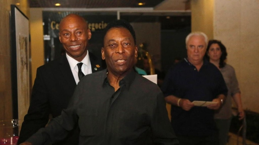 Legendary Cosmos and Brazilian national soccer team player Pele arrives at Melia Cohiba in Havana, Cuba, Sunday, May 31, 2015. The New York Cosmos will play against the Cuban national soccer team in a friendly match on Tuesday. (AP Photo/Desmond Boylan)