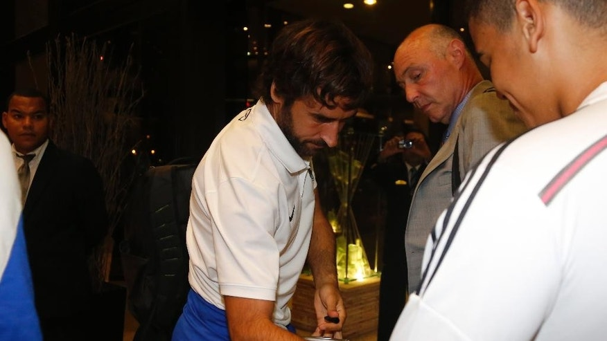 Cosmos player Raul Gonzalez signs the shirt of a fan after arriving at Melia Cohiba Hotel in Havana, Cuba, Sunday, May 31, 2015. The New York Cosmos will play against the Cuban national soccer team in a friendly match on Tuesday. (AP Photo/Desmond Boylan)