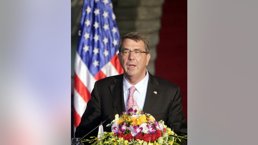 U.S. Defense Secretary Ash Carter speaks to reporters at a joint press conference with his Vietnamese counterpart Gen. Phung Quang Thanh in Hanoi, Vietnam Monday, June 1, 2015. Carter is on a three-day visit to Vietnam to deepen military cooperation between the two former foes. (AP Photo/Tran Van Minh.)