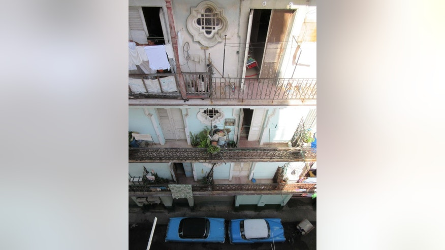 This May 14, 2015 photo shows the view from the window of an Airbnb apartment in Havana, Cuba. In the two months since Airbnb started doing business in Cuba, listing have ballooned to about 2,000. The website makes it relatively easy to find lodging in a country thatís largely been cut off from the online booking systems most travelers take for granted. On the plus side: Airbnb is a great way to connect with locals and see daily life up close. (AP Photo/Beth J. Harpaz)