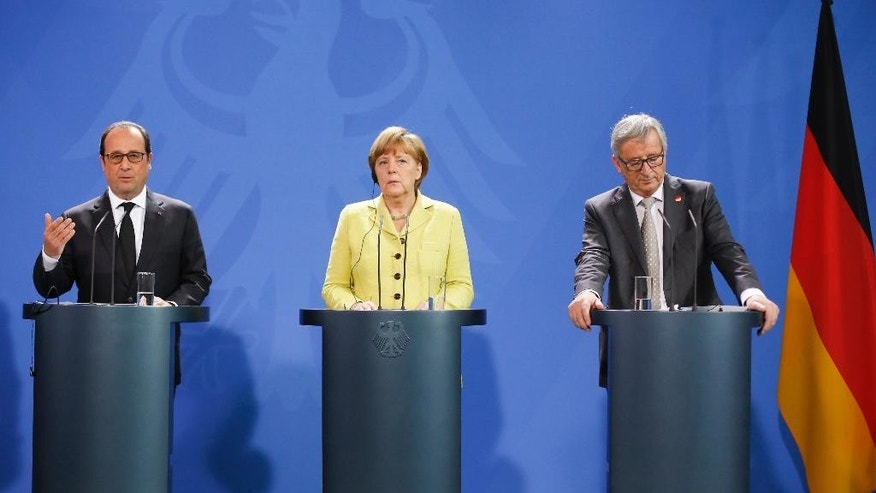 German Chancellor Angela Merkel, center, the President of France, Francois Hollande, left, and the President of the European Commission Jean-Claude Juncker, right, attend a statement for the media prior to a meeting at the chancellery in Berlin, Germany, Monday, June 1, 2015. (AP Photo/Markus Schreiber)