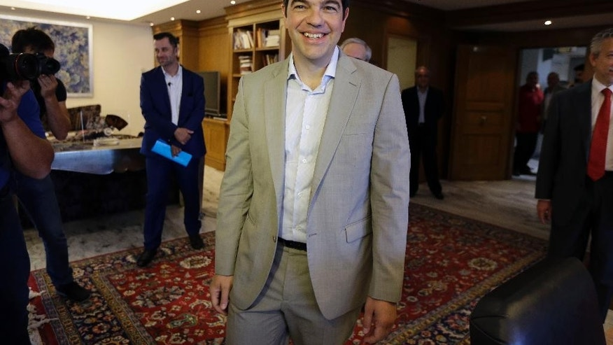 Greece's Prime Minister Alexis Tsipras arrives at the office of the Education Minister in Athens, Tuesday, June 2, 2015. Tsipras says Greece has submitted a proposal for an agreement with its creditors, as Athens seeks a deal that will to unlock desperately needed rescue money. (AP Photo/Thanassis Stavrakis)