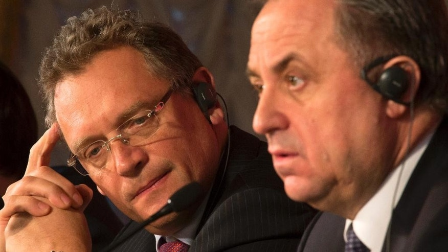 FILE - In this Feb. 16, 2015, file photo, FIFA Secretary General Jerome Valcke, left, and Russian Sports Minister Vitaly Mutko attend a news conference in St. Petersburg, Russia. The New York Times reported Monday, June 1, 2015, that the high-ranking FIFA official who allegedly made a $10-million payment central to a U.S. probe into soccer corruption is believed to be Sepp Blatter's right-hand man, Valcke. (AP Photo/Dmitry Lovetsky, File)