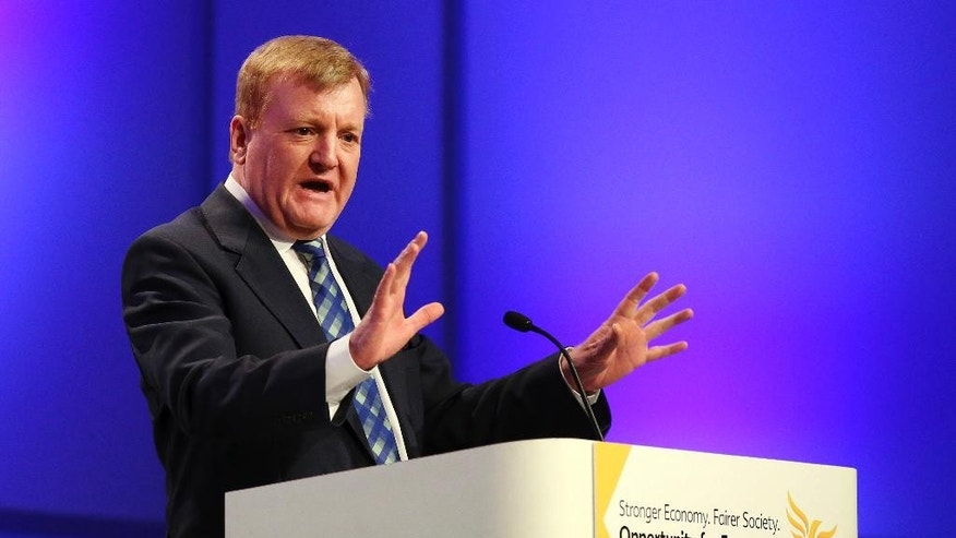 FILE - In this March 20, 2015 file photo former Liberal Democrat leader Charles Kennedy gestures as he speaks at a meeting. Kennedy, who led Britain's Liberal Democrats to one of its best election results ever before resigning dramatically after admitting he was receiving treatment for an alcohol problem, died aged 55, it was announced in a statement on Tuesday June 2, 2015.  (Andrew Milligan/PA via AP, File)  UNITED KINGDOM OUT