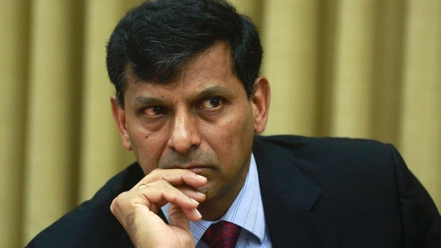 Reserve Bank of India (RBI) Governor Raghuram Rajan attends a press conference in Mumbai, India, Tuesday, June 2, 2015. India's central bank cut a key interest rate by a quarter percentage point Tuesday, the third such reduction this year in support of government efforts to boost growth. (AP Photo/Rafiw Maqbool)
