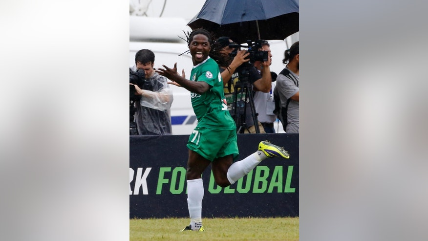 New York Cosmos' Lucky Mkosana celebrates after scoring against Cuba during their friendly match at the Pedro Marrero Stadium in Havana, Cuba, Tuesday, June 2, 2015. The New York Cosmos won the game 4-1. (AP Photo/Desmond Boylan)