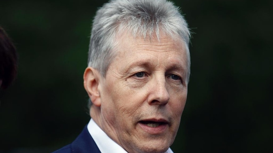 Northern Ireland First Minister Peter Robinson and leader of the Democratic Unionist Party speaks to the media at Stormont, Northern Ireland, Tuesday, June 2, 2015. The British and Irish governments convened Northern Ireland's quarreling parties in a bid to save their Catholic-Protestant coalition.  (AP Photo/Peter Morrison)