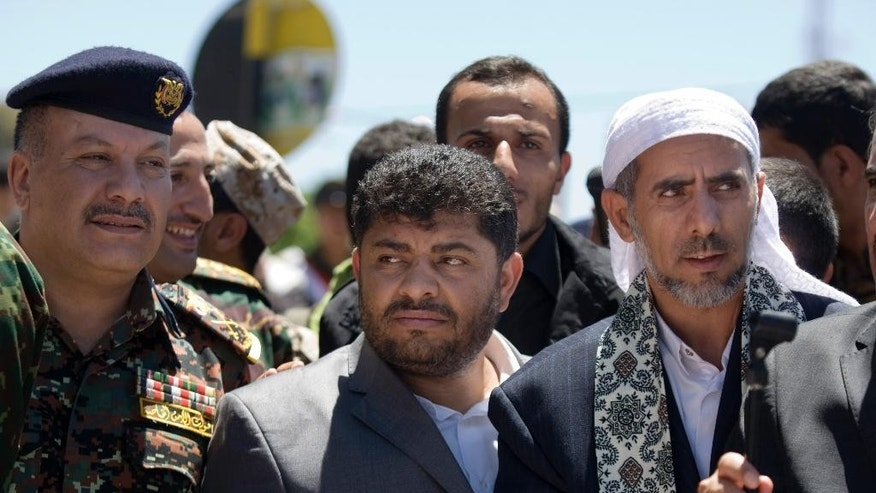 March 25, 2015: In this file photo, Mohammed Ali al-Houthi, who heads the Houthi rebels' powerful Revolutionary Council, center, attends the funeral procession of victims who were killed from triple suicide bombing attacks that hit a pair of mosques in Sanaa, Yemen.