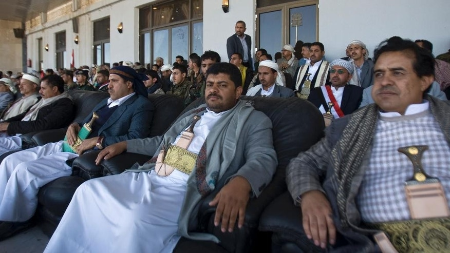 Feb. 7, 2015: Mohammed al-Houthi, center, who heads the Houthi rebels' powerful Revolutionary Council, attends a rally in support of the Houthis at a sports stadium in Sanaa, Yemen.