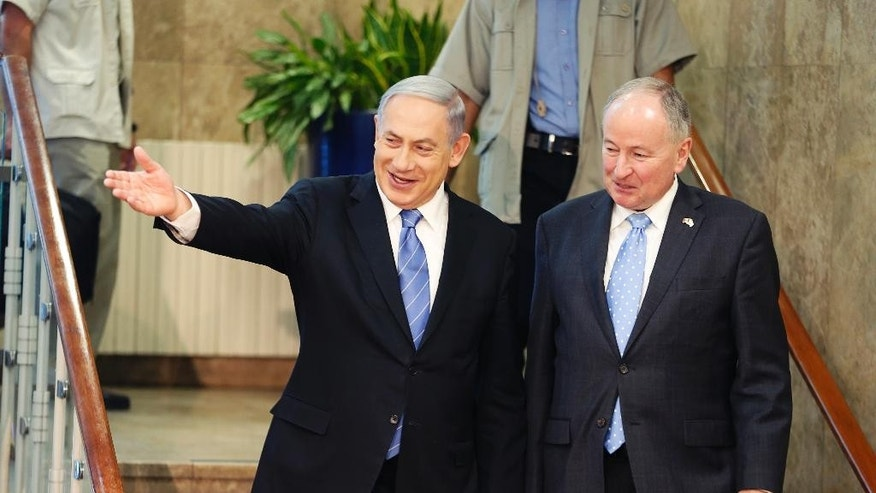 Israel's Prime Minister Benjamin Netanyahu, left, and Canada's Foreign Minister Robert Douglas Nicholson, arrive to deliver statements after their meeting in Jerusalem Wednesday, June 3, 2015. (Ammar Awad/Pool Photo via AP)