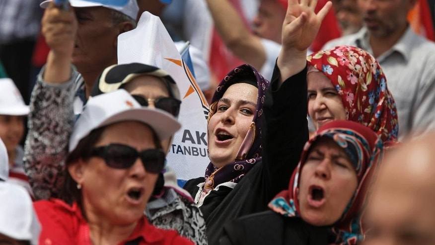 Supporters of Turkey's Justice and Development Party (AKP) chant slogans as they listen to the party leader,  Prime Minister Ahmet Davutoglu, during a rally in Istanbul, Turkey, ahead of the upcoming June 7, 2015 general election, Tuesday, June 2, 2015.  (AP Photo/Lefteris Pitarakis)