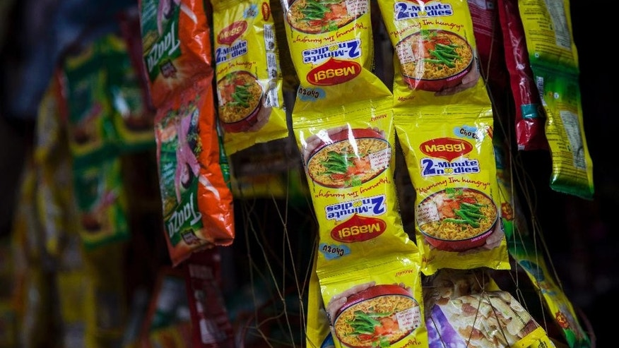 Packets of Maggi noodles hang on display at a shop in New Delhi, India, Wednesday, June 3, 2015. Indian shopkeepers withdrew the popular brand of instant noodle from their shelves Wednesday after tests revealed the snack contained lead above permissible levels. (AP Photo/Tsering Topgyal)