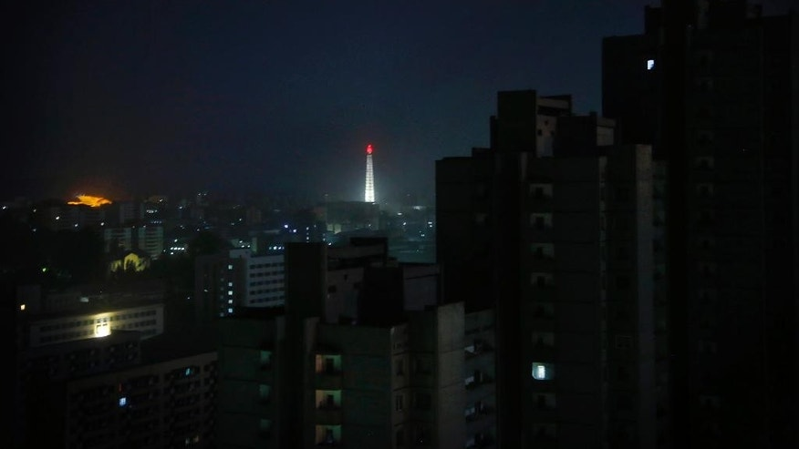 In this May 5, 2015, photo, the Tower of the Juche Idea glows in the distance over the rest of Pyongyang city which is mostly in darkness, in North Korea. North Korea is racing to boost its electricity supply by 20 to 50 percent ahead of a major anniversary later this year and is pushing alternative resources like solar, which is already used extensively in the countryside, to ease its chronic shortages of energy. (AP Photo/Wong Maye-E)