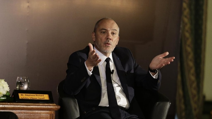 "Stephane Richard, the chief executive officer of French mobile phone company Orange, gestures as he speaks during a press conference in Cairo, Egypt, Wednesday, June 3, 2015. Richard said he would end his company's relationship with an Israeli operator that pays to use its name ""tomorrow"" if he could, but that to do so would be a ""huge risk"" in terms of penalties. He was holding the news conference Wednesday with Yves Gauthier, the chief executive officer of its Egyptian brand Mobinil. (AP Photo/Thomas Hartwell)"