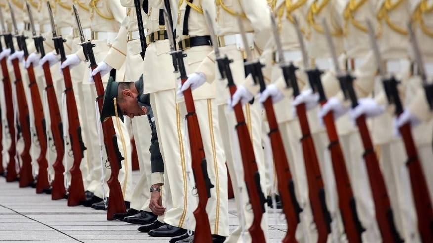 Japan Self-Defense Forces' honor guard prepare to welcome Australian Defense Minister Kevin Andrews and his Japanese counterpart Gen Nakatani to inspect them at the Defense Ministry in Tokyo, Wednesday, June 3, 2015. (AP Photo/Eugene Hoshiko)