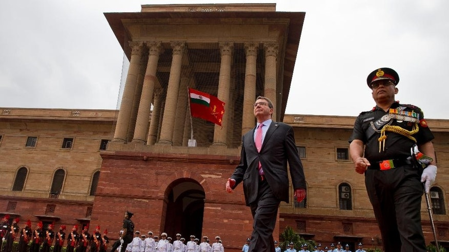 U.S. Defense Secretary Ashton Carter inspects a Guard of Honor during his ceremonial welcome in New Delhi, India, Wednesday, June 3, 2015. Carter is in India on a three-day visit where he is expected to sign a ten-year defense pact. (AP Photo/ Saurabh Das)