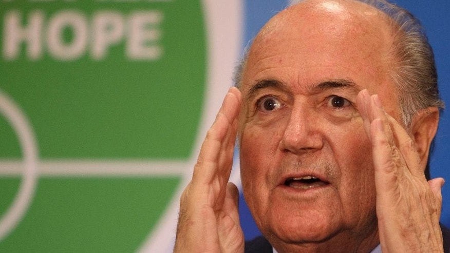 FILE - In this Tuesday, June 23, 2009 file photo FIFA president Sepp Blatter gestures as he speaks at the inaugural 'Football for Hope Forum', during the Confederations Cup soccer tournament, at a hotel in Vanderbijlpark, South Africa. (AP Photo/David Azia, File)
