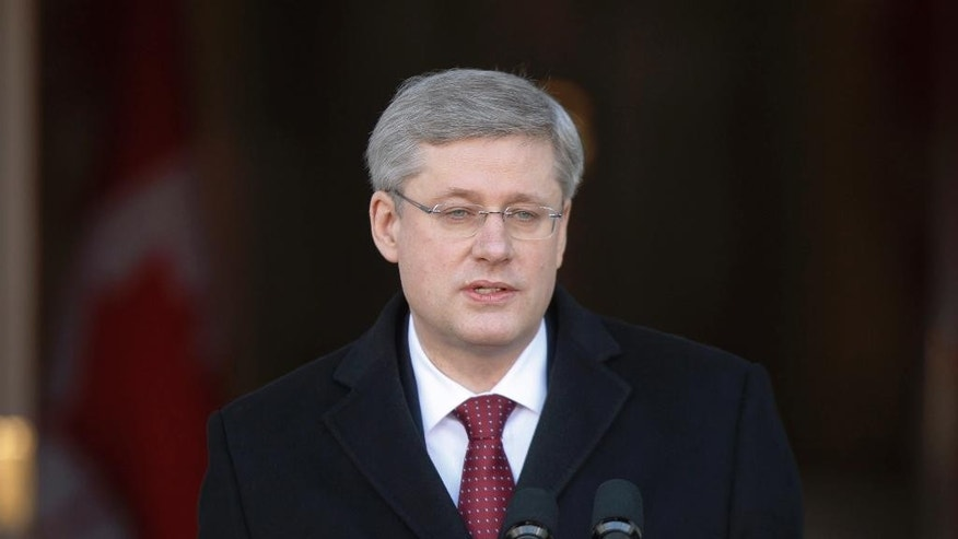 FILE - In this May 2, 2011 file photo Prime Minister Stephen Harper announces a federal election at Rideau Hall in Ottawa, Canada.  Harper said Thursday, June 4, 2015,  Russia should never be allowed back in the Group of Seven as long as Vladimir Putin is president.  He said in an interview with The Associated Press that he expects the group won't ever let Putin back in. He made the remarks ahead of his trip to Ukraine and the Group of Seven meeting in Germany this week.  (Adrian Wyld/The Canadian Press via AP) MANDATORY CREDIT