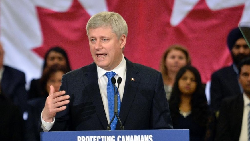 Prime Minister Stephen Harper speaks at a news conference in Toronto on Thursday, June 4, 2015. Harper said that Russia should never be allowed back in the Group of 7 as long as Vladimir Putin is president. (Nathan Denette/The Canadian Press via AP) MANDATORY CREDIT THE CANADIAN PRESS/Nathan Denette