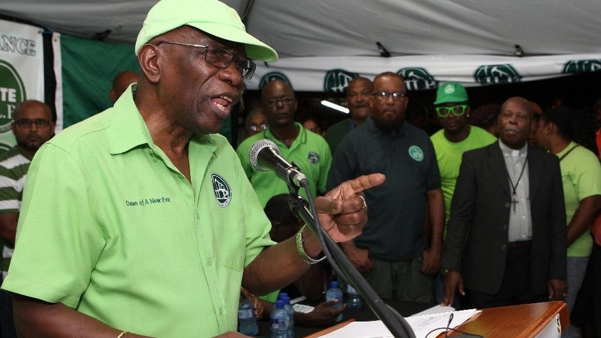 "Former FIFA vice president Jack Warner speaks at a political rally in Marabella, Trinidad and Tobago, Wednesday, June 3, 2015. Warner made a televised address Wednesday night, saying he will prove a link between soccer's governing body and his nation's elections in 2010. Warner also said in the address, which was a paid political advertisement, that ""I reasonably actually fear for my life."" (AP Photo/Anthony Harris)"