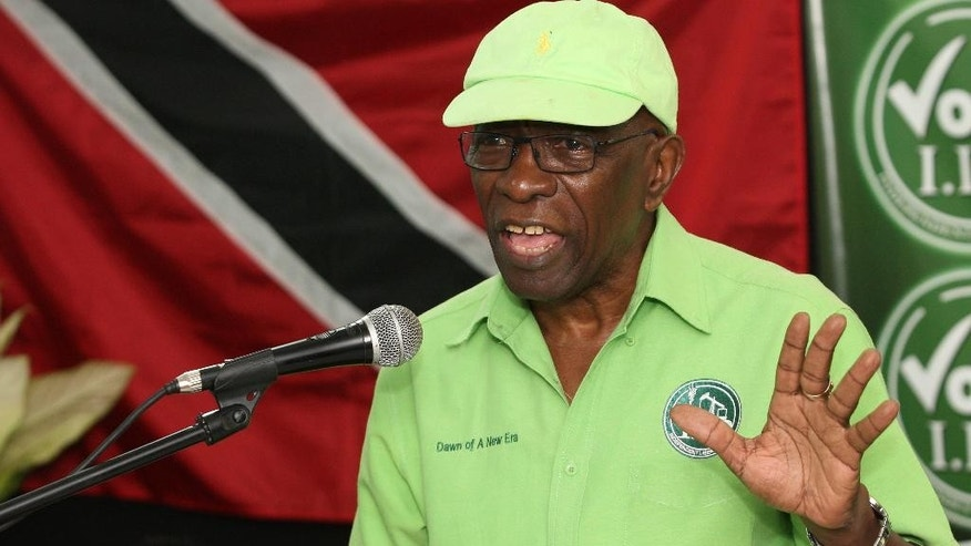 Former FIFA vice president Jack Warner speaks at a political rally in Marabella, Trinidad and Tobago, Wednesday, June 3, 2015. One moment, Jack Warner is on TV telling his countrymen in Trinidad that he fears for his life. An hour later, he's standing on a packed narrow street at a political rally telling supporters that he fears nothing. Indicted by the United States on charges of racketeering, wire fraud and money-laundering, Warner is officially an internationally wanted man, listed as one of Interpol's most wanted persons. (AP Photo/Anthony Harris)