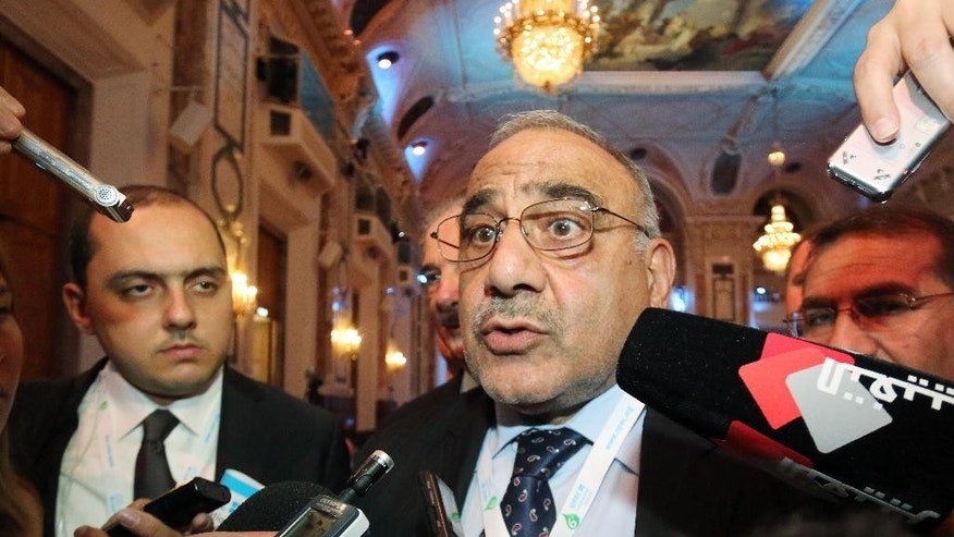 Iraq's Minister of Oil Adil Abd Al-Mahdi speaks to journalists during a seminar of the Organization of the Petroleum Exporting Countries, OPEC, at the Hofburg palace, in Vienna, Austria, Wednesday, June 3, 2015. (AP Photo/Ronald Zak)