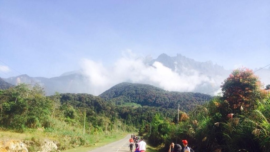 Tourists walk away from Mount Kinabalu hours after a magnitude 5.9 earthquake shook the area in Kundasang, Sabah, Malaysia, Friday, June 5, 2015. The quake struck northwest of Ranau district in Sabah state in Borneo early Friday at a depth of 54 kilometers (34 miles), Malaysia's meteorological department said. (Source via AP) MALAYSIA OUT, NO SALES, NO ARCHIVE