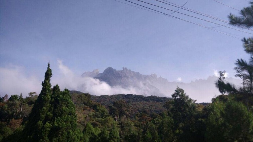 Mount Kinabalu is photographed hours after a magnitude 5.9 earthquake shook the area in Kundasang, Sabah, Malaysia, Friday, June 5, 2015. The quake struck northwest of Ranau district in Sabah state in Borneo early Friday at a depth of 54 kilometers (34 miles), Malaysia's meteorological department said. (Source via AP) MALAYSIA OUT, NO SALES, NO ARCHIVE