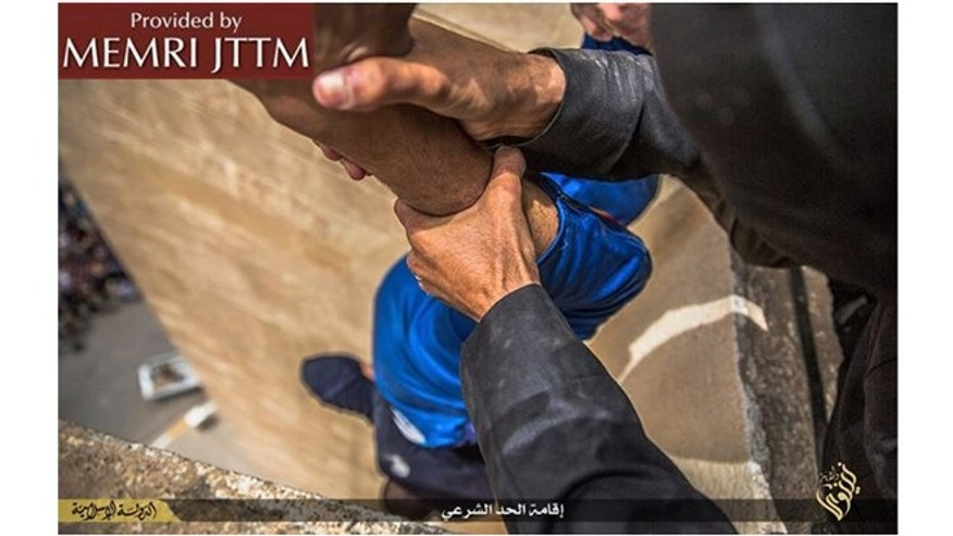 ISIS militants publicly executed three unidentified men by throwing them off the roof a building in Mosul as hundreds gathered to watch.The condemned were held by their feet and dropped head first.