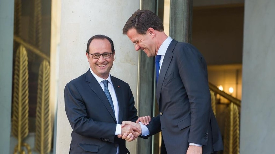 French President Francois Hollande, left shakes hands with Dutch Prime Minister Mark Rutte after their meeting at the Elysee Palace in Paris, France, Wednesday, June 3, 2015.(AP Photo/Kamil Zihnioglu)