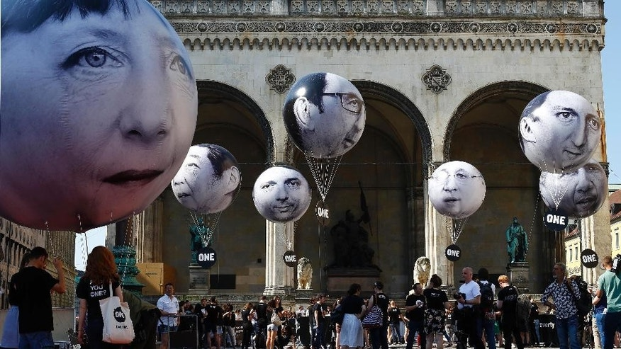 Activists of the international campaigning and advocacy organization ONE installed balloons with portraits of the G-7 heads of state in Munich, Germany,  Friday, June 5, 2015. (AP Photo/Matthias Schrader)