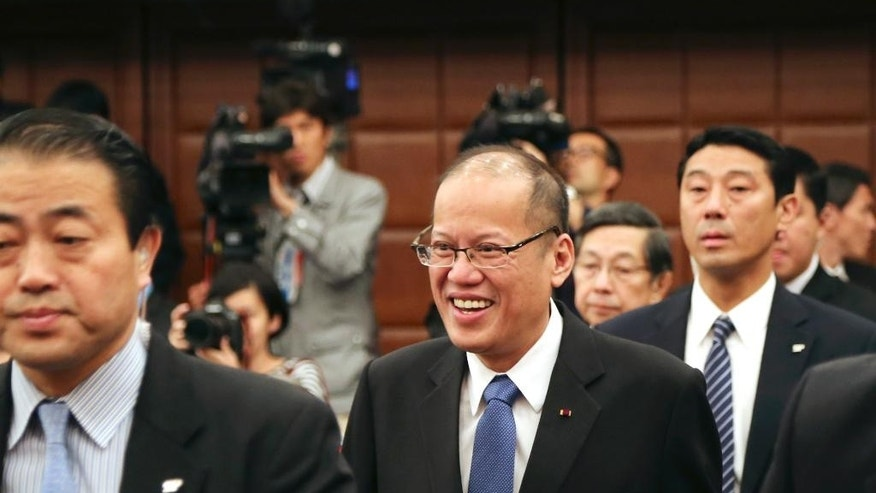 Philippine President Benigno Aquino III arrives for a press conference at the Japan National Press Club in Tokyo, Friday, June 5, 2015. Aquino said he wants to start talks toward signing a pact legally allowing Japanese troops to visit his country and join a wide range of operation, signaling expanded Japanese troop presence in the South China Sea. Aquino said a visiting forces agreement would accommodate refueling and other needs for Japanese troops while in the Philippines. Manila has similar deals with the U.S. and Australia. (AP Photo/Koji Sasahara)
