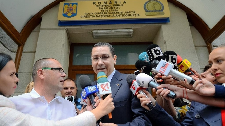 Romanian Prime Minister Vctor Ponta exits the anti-corruption prosecutor's office in Bucharest, Romania, Friday, June 5, 2015. Ponta told media that he was suspected of making false statements, money laundering and being an accomplice to tax evasion while working as a lawyer from 2007 to 2008 when he was also a lawmaker for the Social Democratic party. Romania's president on Friday urged Prime Minister Victor Ponta to resign over corruption allegations but Ponta refused, saying that only Parliament could dismiss him. (AP Photo/Octav Ganea, Mediafax via AP) ROMANIA OUT