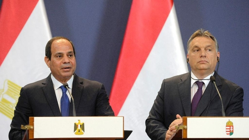 Egyptian President Abdel Fattah al-Sissi, left, speaks during a joint press conference with Hungarian Prime Minister Viktor Orban in the Parliament building in Budapest, Hungary, Friday, June 5, 2015. El-Sissi is staying on a two-day visit in Hungary. (Zoltan Mathe/MTI via AP)