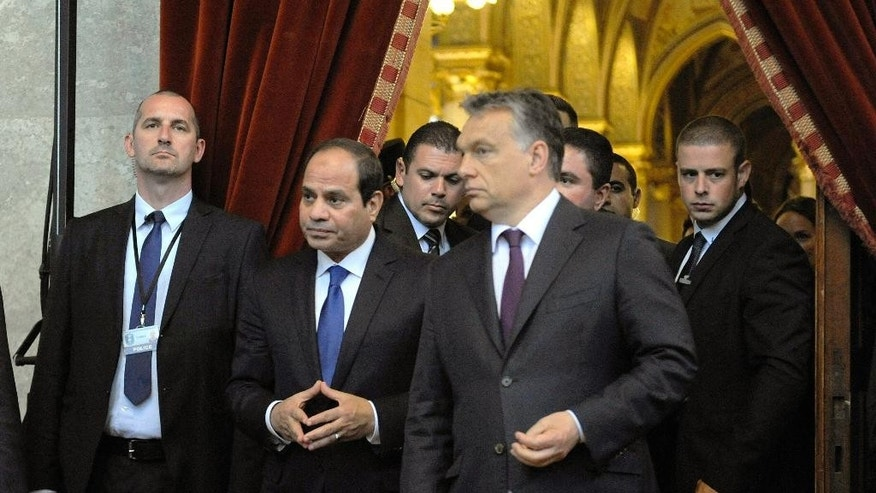 Egyptian President Abdel Fattah el-Sissi, second left, and Hungarian Prime Minister Viktor Orban, second right, arrive for a signing ceremony in the Parliament building in Budapest, Hungary, Friday, June 5, 2015. El-Sissi is staying on a two-day visit in Hungary. (Zoltan Mathe/MTI via AP)