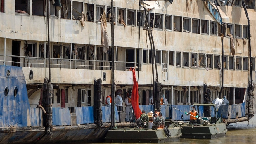 June 6, 2015: In this photo released by China's Xinhua News Agency, rescuers work in the hull of the upright Eastern Star ship to launch rescue work in the section of Jianli on the Yangtze River, central China's Hubei Province.