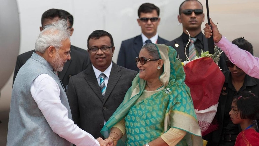 Bangladesh's Prime Minister Sheikh Hasina shakes hand with Indian Prime Minister Narendra Modi upon his arrival at the Hazrat Shahjalal International airport in Dhaka, Bangladesh, Saturday, June 6, 2015. Modi is on a  two-day official visit to Bangladesh. (AP Photo/A.M. Ahad)