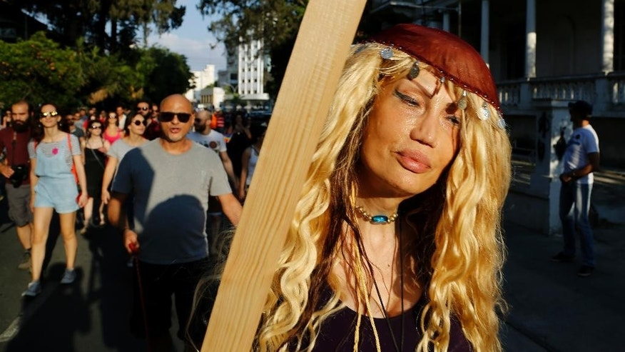 A participant takes part in a second gay pride parade in downtown Nicosia, Cyprus, Saturday, June 6, 2015. Several thousand people marched in the streets of Cyprus' capital for the east Mediterranean island nation's 2nd gay pride parade as detractors stayed away. (AP Photo/Petros Karadjias)