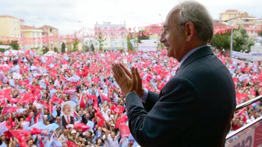 Turkey's main opposition Republican People's Party leader Kemal Kilicdaroglu addresses an election rally in Istanbul, Turkey, Saturday, June 6, 2015. Turkey holds parliamentary elections on Sunday in which the Kurdish votes will be crucial in determining whether the ruling party gets the supermajority it seeks. (AP Photo)