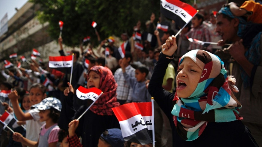 "June 6, 2015: Yemeni children chant slogans and wave Yemeni flags which have the Arabic, ""Yemen one,"" written on them, during a protest against Saudi-led airstrikes, in Sanaa, Yemen."